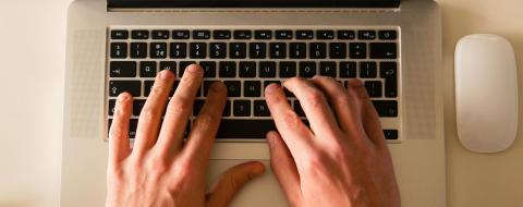 Person typing on their keyboard